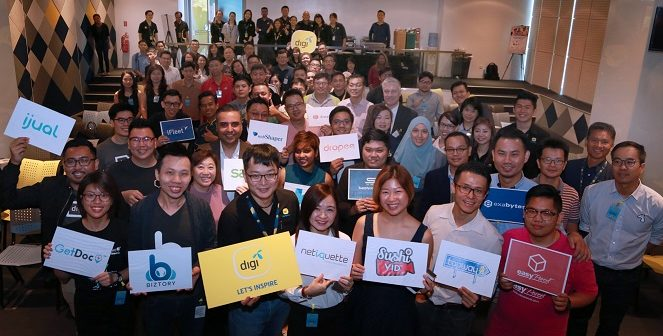 (Wearing Digi lanyard) Eugene Teh, Digi's Chief Business Officer with the 16 partners at the soft launch.